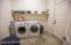 Laundry room with access to the garage.