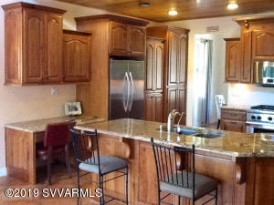 What an amazing private oasis! Beautiful grounds with huge trees, a gardeners paradise!Home has too many upgrades to list here, it is well laid out with a lovely guest quarters above the garage,Paver driveway and walks, home has central vac, granite counter tops, formal dining room. Loft and even a hidden room.  Soft close alder Cabinets, tile and carpet, gas fireplace,wonderful wraparound deck,