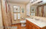 Master Bath, spacious with linen closets and a shower/tub.