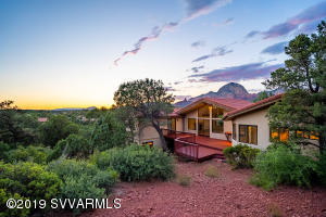 Welcome to 245 Panorama Blvd perched to take in Thunder Mountain Views and offer privacy off the back due to National Forest.