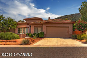 Gorgeous like new custom home located on the ninth hole of the Sedona Golf Resort with red rock views. This home is located on Upper Crown Ridge and shows like a model. This 3/3/study Jerome plan has custom upgrades. Please see Supplement for additional information.