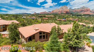 Come savor this gracious and elegant, pride of ownership home! Nestled in the premier, gated community of Les Springs and enjoying dramatic red rock views. Thoroughly updated with fresh design and decor.  Bright, light, open and airy, with soaring ceilings and dramatic view windows. Master suite offers private balcony with stunning views, walk in closet, separate garden tub and shower and dual sinks with granite countertop. Open kitchen boasts granite countertops, newer appliances, upgraded cabinetry, walk in pantry and a sunny breakfast area. Great room includes gas fireplace, Travertine stone, art alcoves and niches. Inviting covered patio off of dining area is perfect for morning coffee or relaxing at sunset. Freshly painted exterior and newer heating and cooling systems. SEE SUPPLEMENT
