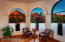 Three large picture windows showcase the incredible multiple red rock formations visible from Great Room.