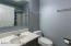 Hallway bathroom with tub/shower, new toilet & new flooring
