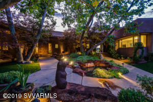 $2.45M UNDER APPRAISAL. Privately Gated 15.69 Acre Estate. Uninterrupted RED ROCK VIEWS and owned well & Solar Pool. NO HOA for the 14.07 acres. Estate designed by renowned architect Don Woods. It's ideal for large/extended family living OR as a corporate/executive retreat location offering wide-ranging, desirable ammenities, & high quality construction. Lavish, comfortable, meditative, contemplative and relaxing, and motivational spaces accommodate day or evening, casual or formal activities. Enjoy stunning 360-degree RED ROCK views from the spacious master suite, sumptuous library or offices and indoor pool. Estate includes main and guest-houses, and convenient live-in staff quarters.Potential for building a separate collector car garage, vineyard, or horse facilities!