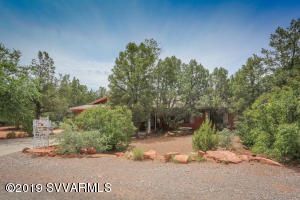 Spacious home in West Sedona with amazing potential. Great layout with this split floorplan that features a large master with bath, two family room living areas, centrally located kitchen, large garage, separate laundry room, and additional rooms off the back that could be used as office space, craft, or meditation rooms. Nestled in a nice neighborhood, and close to all Sedona has to offer. Resale and rental possibilities.