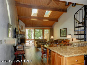 Rough Hewn wood beams, wood floors and solid granite counteres.