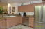 Kitchen area with dishwasher, stainless steel appliances
