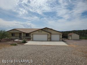 This quality home features a spacious floor plan on 1.6 acres. New tile floors in living areas and new carpeting in bedrooms.   Backyard has new fence and landscaping and new 10 x 16  foot shed. Many upgrades include water softener and hot water heater. There are panoramic views of sunsets and sunrises over Mingus Mountain, Sycamore Canyon, Sedona,. The kitchen features an Island and granite countertops. The master bedroom has vaulted ceilings, a large bathtub and a separate shower. Oversized 3 car garage with epoxy floor covering and storage cabinets. Country feel, yet only minutes to shopping, dining, and medical facilities.