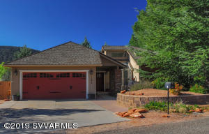 Oversized 2 car garage, covered entry, architectural shingles.