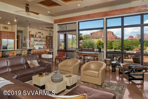 This contemporary home features large windows to bring the Red Rock views into each room!