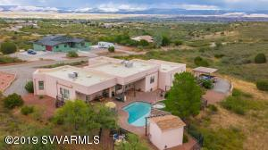Absolutely stunning home with panoramic views of the Verde Valley, Sedona Red Rocks and Mingus Mountain. This is an incredible home for entertaining with pool, Hot Tub and huge covered and open patio's. There is also a courtyard with dolphin fountain in the front. Your private retreat is waiting for you. This stunning home was custom built and sets on 2 acres in the foothills of Mingus mountain. Some of this homes features are Tile throughout, Granite counter tops, one of a kind custom petrified wood sinks in the master bathroom, Kiva fireplace in the living room, Huge master suite and lots of windows to bring in the natural lighting, huge open concept design, and so much more. Everything is immaculate from floor to ceiling. Schedule your private tour today.