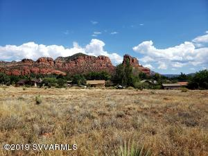 Beautiful red rock & panoramic views from this level & slightly sloping lot located in the Big Park area of Sedona. Great building site with lots of room to place your home, watch the sunrise & sunsets, plus the amazing night sky!  No HOA fees, building permit is under Yavapai County jurisdiction. Come build your dream home in Sedona!