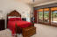 master suite with full wall of windows and patio door to full length covered back patio