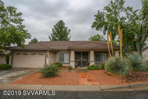 Take a look at this gorgeous home! It features three spacious bedrooms, plus a den. Built for entertaining with a large living room, dining room and covered patio. The back yard is fully enclosed with a beautiful wrought-iron fence. Two-car garage. This home is complete with owned solar panels.