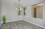 with Plank Tiled Flooring, 2 Tone Paint, Dining Light, Sunny Windows & Tall Ceilings.