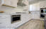 with Custom Cabinetry & Quality Stainless Appliances!
