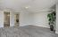Spacious Master Bedroom with Designer 2 Tone Paint, Tall Baseboards, Ceiling Light, Sunny Windows & Plank Tile Flooring.