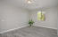 with Plank Tile Flooring, Side Window, Ceiling Light, 2 Tone Paint, Large Baseboards and Built In Desk Area.