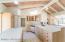 Gas Appliances, Sub-Zero fridge, Kitchen Island w/Sink & Breakfast Bar in Kitchen