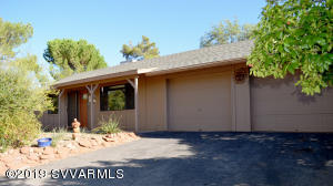 This may be your chance to fulfill your dream of living in Sedona at a great price! Move in ready, well kept 2 bedroom 2 bath single family home with Red Rock views from living room and guest bedroom. Tile floors throughout. Covered back and front patios. Large 2 car garage with lots of shelving space. No expensive HOA, only $180 per yearl A great rental (30 day minimum), or place to call home. New roof in 2018. Only minutes from restaurants, groceries. shopping and hiking trails.