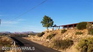 Luxurious, sweeping and panoramic views of Sedona Red Rocks and The Mingus Mountains. Perched on a hill overlooking the 247.75 acre Brockett Ranch. Perfect front yard with a Pergola and a spacious comfortable area for entertaining or relaxation. Trails close by. ABOUT - 7 minutes to the freeway, 20 minutes to Sedona (Village of Oak Creek), 30 minutes to Cottonwood, 45 minutes to Flagstaff -. Lots of elbow room in the kitchen with a large pantry, granite counter tops, stainless steel appliances. High ceilings in the living room with lots of light streaming in through large windows. An extra large family/hobby/activity room. Beautiful sunrise(s) and sunsets from the vantage point of this location. Inviting, and exciting. Come see !!!