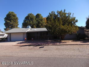This is a very nice home in the Rimrock community. A new roof was just completed. The yard has mature landscaping with lots of summer shade! There is a large garden shed in the back yard. The exterior has low maintenance siding with accents in old phoenix brick. There is a large great room with a brick, wood burning fireplace. Built-in shelving completes this accent feature. There are skylights throughout the house. Included is a soft water system along with an R/O system. In the kitchen are nice cabinets and counter tops. A large dining room is off the kitchen. A built-in hutch is included in the dining area. A large service porch has hookups for a washer and dryer. This is a great home! Stop by for a look!