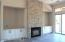Cabinets included on both sides of fireplace.