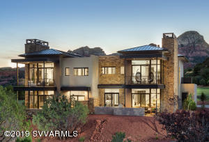 The front exterior of the Enclave #1 townhome shows the beautiful stone & metal finishes