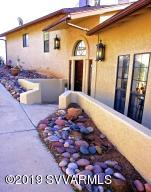 Inviting foyer takes you to unique one of a kind custom built home with unbelievable panoramic mountain and vista views. Privacy and peacefulness abounds, watch the wildlife.View the beautiful skies at night. Home is bright and cheery with light coming through many windows. Easy to landscape and maintain,Low electric bills in this all electric home. Lots of parking. Dog run.Kitchen has snack bar and eat-in area with laundry room and half bath off of it. DR. has built-in shelves LR, has wood burning fireplace. Family room has woodstove and patio doors leading to gorgeous views, possible mother-in-law suite, oak flooring. Library/den has built -in shelves and berber carpeting. Many ceiling fans, sky lights and arched doorways. Custom blinds. A must see.
