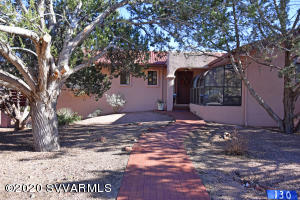 What a wonderful home! This spacious 3 bedroom 3 bathroom home sits high but also has a level entryway. Beautiful views of the red rocks embrace all of the exterior decks and outdoor spaces. Large 3 car garage with storage and a workspace, a fantastic studio room with a terrarium, wood stove, and separate entry add to the real appeal of this home. Minutes from golf courses and shopping yet quietly sitting out of the main traffic areas. This home has already been appraised for more than asking price. Inspections done and repairs made! Welcome home!