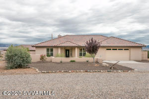 This custom built home with detached studio has red rock views and views of Mingus Mountain. Home sits on 1.6 acres and is located in a beautiful neighborhood. Offers a custom fiddle back maple package with solid surface tops and integrated sinks. Stainless steel appliances. Pre-plumbed and wired for central vac and jacuzzi. Includes 2 two car garages with lots of room for RV or other parking. Plenty of large windows and patio space to enjoy the outdoors. Detached garage/studio with mini split heat/cool makes this a very versatile find.