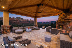 Extraordinary custom home built in 2018, located in one of West Sedona's most exclusive areas, ''Soldier's Pass''. This home exudes privacy, backs up against National Forest with Coffee Pot in your view corridor. The main residence features 4,838 SqFt with an elevator, three bedrooms, studio, library/study, family room, great room, gourmet kitchen, and laundry. The Guest Casita provides 492 SqFt with a king bedroom/bathroom suite and kitchenette area. Garage houses 4 cars + Tesla charging station. This property offers one of the most outstanding outdoor living spaces in Sedona including a cascading waterfall feature, outdoor kitchen & dining and a 2,400 SqFt Ramada. Home has an owned solar system providing ample power for lighting, appliances, and electric car charging station...
