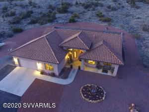 This is a stunning Tuscan style custom built home in a very private, peaceful area with 50 feet of Oak creek frontage on 13.3 acres! This home is a 3 bedroom, 3 bathrooms plus a den and a recreation or game room. The kitchen is well appointed with high end appliances to include a six burner gas stove top range, convection/microwave oven and a walk in pantry. Bay and angled windows throughout all stamped with the quality of Pella windows. Outdoor living from fishing on Oak Creek to enjoying the gazebo in the the backyard. If you are a star gazers You will love looking at the Milky Way in our clear skies of Arizona! This is your private oasis!  Adjacent Land on 9.69 acres is also available. See MLS #520837 and combine for a 23 acre Estate with irrigation for Vineyard or ?