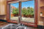 Enjoy Red Rock views from numerous areas of this beautiful home!