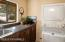 Spacious w/sink, cabinets, stack able Maytag washer and dryer.