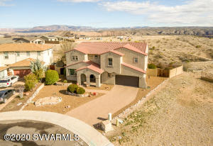Your Dream home is finally here. Other-worldly views from this MAGNIFICENT HOME on -1/4 acre! Barely lived in & immaculately kept, this home feels Brand New! Views of Mingus Mountain & Sedona's Red Rocks from every room of this lovely 4 bed w Den, 4 bath/3 car (w/ workshop) home. BONUS ROOM, Separate Living Room & Family Room w gas fireplace. Gourmet kitchen w Stainless Appliances, new refrigerator & Maple cabinets. Thick, bull-nose Granite throughout. Open, iron-rail staircase. Custom lighting. Downstairs bedroom w full bath. Huge Master suite w 2 walk-in closets & extensive windows, seems to hang over the Red Rock Canyon. Master bath w step in shower & great water pressure (new pressure valve installed). All of this, on a private cul-de-sac, with unobstructed views forever. ONE-OF-A-KIND