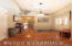 Warm & welcoming - open foyer with vaulted ceiling & skylight