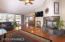 Large living room with gorgeous floors, French doors out to the deck, & a marvelous gas fireplace