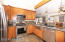 ...stainless steel appliances and farm-sink, contemporary lighting. Just beautiful!