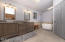 Stunning brand new master bathroom area. Quartz counter tops, dual vanity with square sinks and one heck of a new tub....