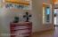 Corner room for bunk beds, a desk or comfy reading suite.