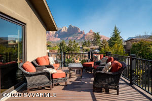 Uptown Oasis w/relaxation in mind. Trex deck w/great views, ramp from side yard.