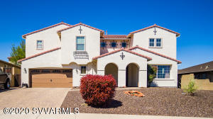 Spanish Beauty looks exquisite, All the best touches, large pull through garage (front & back garage doors), Room for all of your family: Great Room with cozy fireplace & kitchen access, separate living & family rooms, A cook's delight with maple cabinetry & stainless appliances, Butler's pantry (5x5) Designed rail staircase, office/bookshelf area, large rec or family room upstairs, one downstairs guest bedroom with guest bath, 2 master suites upstairs, master (1) has 2 huge walk-in closets with separate tub shower and 2 separate vanities including a makeup area, pavers in covered patio areas, small child's play house, lots of storage, exterior paint is newer, nice landscape/easy care. Covered front (14x13) & back patios (30x7), Backyard is very private! You must see!