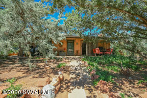 Conveniently located in the heart of west Sedona you will find this hidden cottage gem. This 3 bedroom, 2 bathroom home is ready for a new owner. This home sits on a large .42ac lot offering mature landscaping and it is just minutes from hiking, shopping and entertainment. Located in an area outside of an HOA this property would make an amazing rental/investment property or quick weekend getaway. The property also features a detached carport with a shed and a fenced backyard. This a truly a unique property! Schedule your showing today!