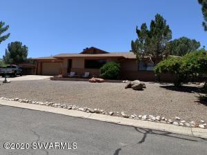 One of Clarkdale's favorite neighborhoods! Walking distance to Yavapai College. Only a couple miles from Old Town and all the fun to be had there. Amazing Red Rock Views from your large front window. Backyard is your own personal park with a Fire Pit, shed/workshop, gazebo, raised garden beds and plenty of room for more on this large corner lot with mature trees. Oh! The home! Two Master suites, complete remodel in 2014, dream kitchen, granite counters, custom cabinets, ambient lighting and more! Bathrooms have also been updated with tile showers. Master has built in dressers and entertainment center. NO HOA, VRBO ok or the perfect family home, either way don't miss this one, it is sure to go fast.