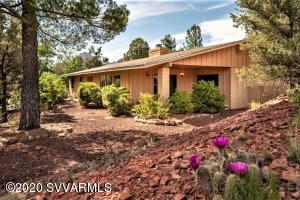 The single level home is tucked away from the street on a PRIVATE .42 ACRE!