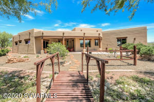 Looking to have privacy & get away from it all? Stunning Santa Fe home backs to National Forest & is nestled on 2 acres. Enjoy gorgeous views & sunsets over the Mingus Mountains. Relax & stargaze in peace & tranquility. Owners have lovingly cared for home & have done many upgrades. New HVAC $7,000, Vigas replaced $5,500, Wood posts on back patio $3,000, Landscaping $5,000, Synergy stucco $27,500 & to finish it all off a $41,000 (20'x40') man cave!! Plus generate extra income, there is an RV available on a separate bill of sale, owners are using it for AirBnB or you can use it as a guest suite. Close to Sedona, minutes from Cottonwood, shopping, restaurants, hiking & wine tasting. Horse allowed. This home will inspire you... Come see why so many people are calling the Verde Valley home!