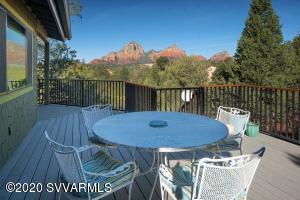 The charm and character of Sedona awaits you in this Uptown beauty! Secluded behind a gated entry in a tranquil wooded setting filled with mature trees, sweeping awe-inspiring Red Rock views, relaxing water feature which gently flows onto a meandering brook to a small pond, plus a gentle breeze embracing the expansive wrap-around deck - all designed to SOOTHE YOUR SOULl! Begin your day with morning coffee on the 2nd deck, while gazing upon Snoopy Rock! Home features 3 bedrooms, 2 baths and potential 4th bedroom/office/studio with separate entrance. Master Bedroom En-suite Retreat features 2 closets, Red Rock views and sliding doorway to rear deck. Remodeled Kitchen is one of many upgrades. (See List) Great walkability to hiking trails and Uptown Sedona restaurants, shops and galleries.