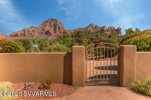 Centrally located in West Sedona. View wrapped front entry courtyard welcomes in this single level home with panoramic views through big picture windows & glass patio doors. Open great room design with vaulted ceilings & skylights! Living room has gas fireplace. Kitchen offers upgraded cabinets & granite counters, natural gas cooking, stainless appliances & pantry. BBQ patio off kitchen/dining area. Oversized 2 car garage. Brick paver driveway. Home is prewired for security & central vac.